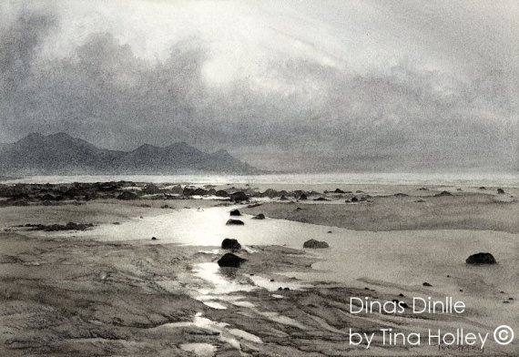 Watercolour painting by Tina Holley looking over Dinas Dinlle beach just south of Caernarfon in North Wales. The atmospheric light over the beach sets against Yr Eifl or the Rivals; the mountains along the Lleyn Peninsula.